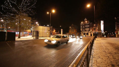 Vehicles on road at night, Hammersmith, London, United Kingdom Live Action