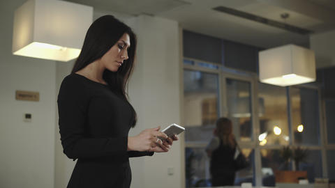 Business woman standing in the office and talking with a tablet Footage