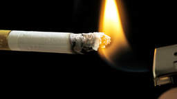 Cigarette On A Black Background, Lighter And Smoke stock footage