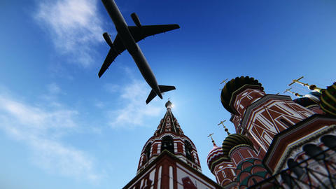 Plane passing at The Cathedral of Vasily the Blessed in Moscow, Russia Footage