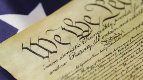Historical Document US Constitution - We The People with American Flag Footage