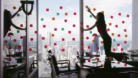 1 Business Person Attaching Sticky Notes On Large Window Footage