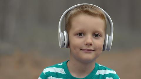 Happy Little Boy With Headphones Outdoor Footage