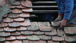 Workers covering a roof with tile 06 Footage