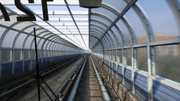Lined tunnel rushing forward futuristic transit, real-time shot Footage