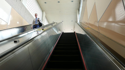 Escalator travelling up, office employees on opposite direction Footage