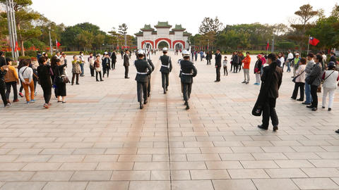 Soldiers march at square to gate, tourists flock around ceremony Footage