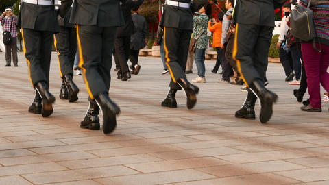 March soldiers legs, boots and uniform, stomp on pavement with brisk sound Footage
