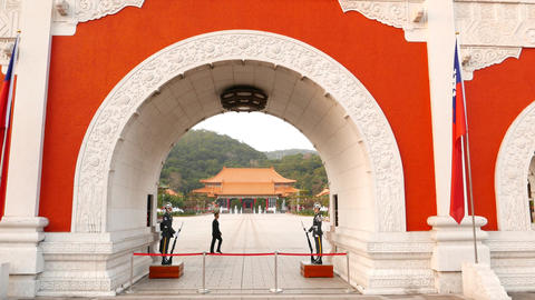 Paifang at Taipei Martyr's Shrine, view from arch passage tilt up to gable Footage