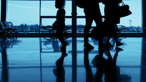 Airport. Unrecognizable Silhouettes of Passengers Footage