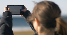 woman taking photographs using mobile cell phone camera Footage