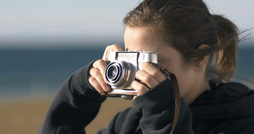 girl taking photos with old film retro style camera Footage