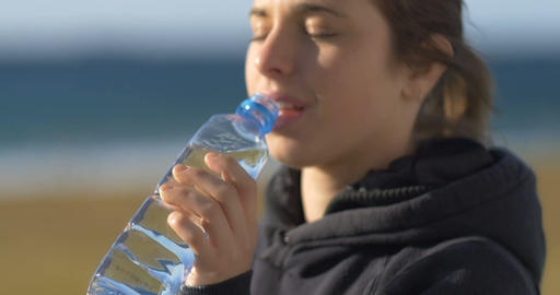drinking fresh water from a recycled plastic water bottle young adult Live Action