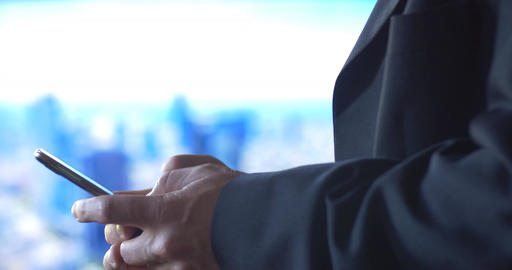 Business Man Texting Using Mobile Cell Phone Technology City Background stock footage