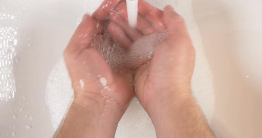 Washing hands in sink with soap to clean skin for good hygiene Live Action