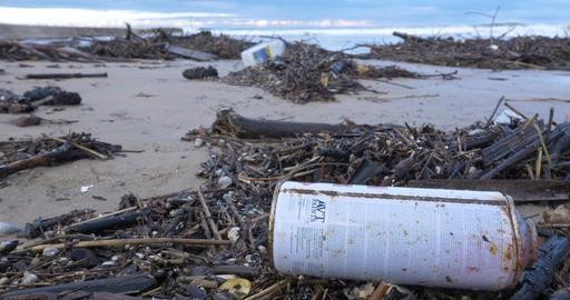 garbage waste water pollution on beach by ocean sea Footage