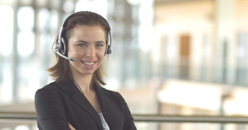 Smiling call centre customer service support operator receptionist woman headset Footage