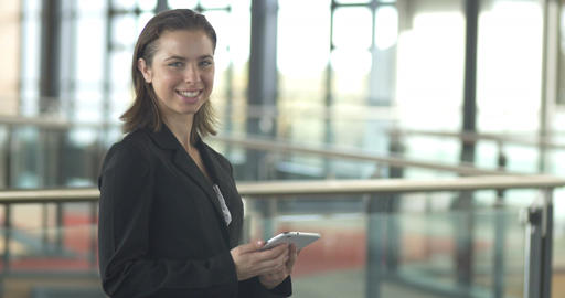 Business woman corporate career looking at tablet PC in office Footage