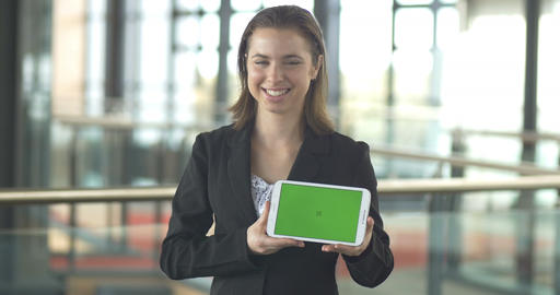 Selling with green screen tablet sales logo promotion in corporate office Footage