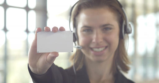 Blank business card businesswoman with headset holding in office Footage