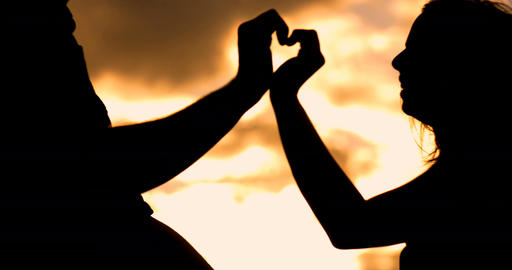 Heart shape with hands silhouette romance of a young couple lifestyle Footage