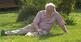 Retired Elderly Man And Dog Relaxing Outdoors Enjoying Retirement stock footage