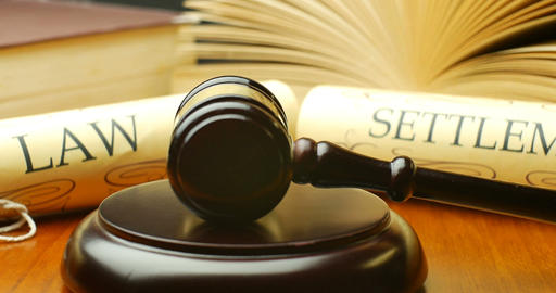 Law settlement justice litigation concept with gavel and hammer Live Action