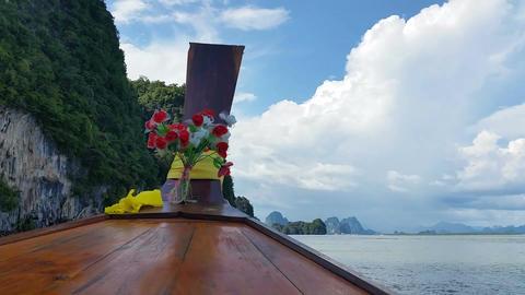 Thailand Longboat through limestone islands Footage