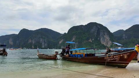 Asia Longboats on Phi Phi Island Thailand - Holiday Travel Destination Footage