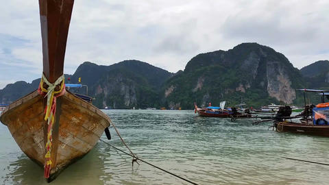 Asia Longboats on Phi Phi Island Thailand - Holiday Travel Destination Footage