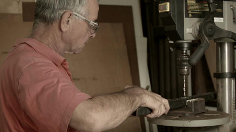 Retired Man 50s-60s working indoors in hobby shed or… Stock Video Footage