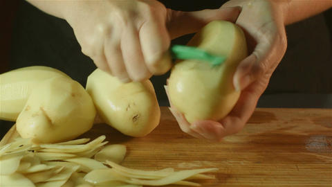 healthy fresh food prep cutting up of vegetable pumpkin potato in kitchen Footage