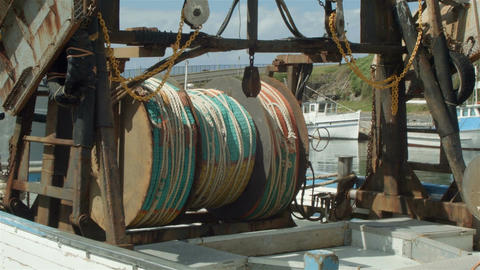 Commercial Fishing Boat with nets in harbour Live Action