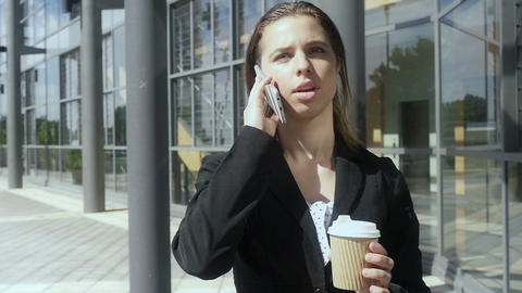 Business woman walking drinking coffee outside building Slow motion Footage