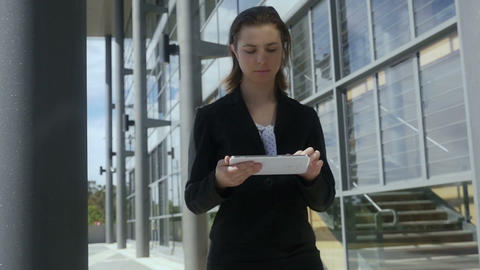 Slow motion young businesswoman walking working tablet pc outside Slow motion Live Action
