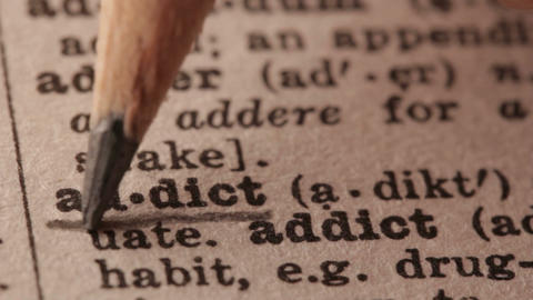 Addict - Fake dictionary definition of the word with pencil underline Live Action