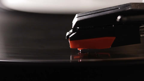 Close up of vinyl record on DJ turntable record player Live Action