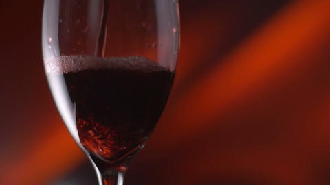 Red wine poured into wine glass highspeed slow motion Footage