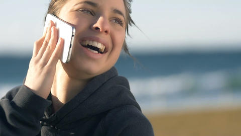 Laughing Girl talking on phone smiling looking happy outdoors Footage