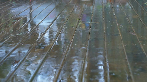 Wet Weather Rain Drops Splash on Wood Surface Footage