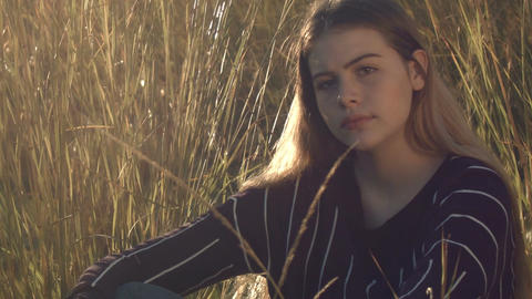 attractive young woman model posing portrait in grass field outdoors Footage