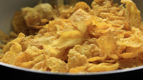 Breakfast Cereal Food Corn Flakes being poured into Bowl Live Action
