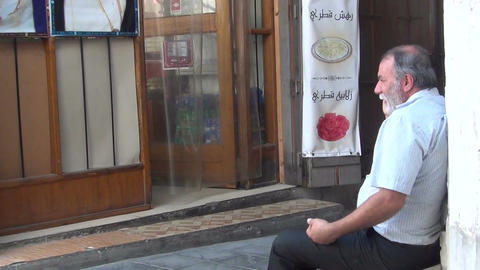 Man has phone conversation on the street Stock Video Footage