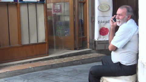 Man has phone conversation on the street Footage