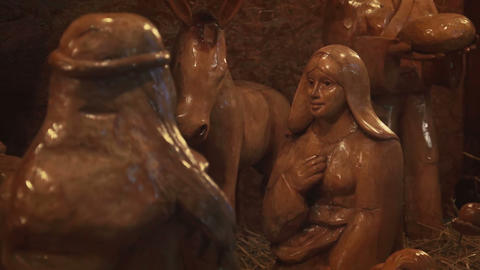 Wood carved sculpture of Virgin Mary in Betlehem at christmas marketplace Footage